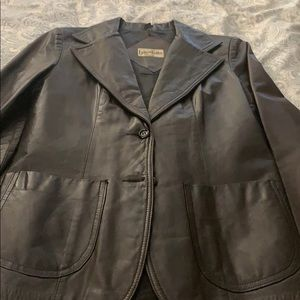 Canadian made 100% brown leather jacket.